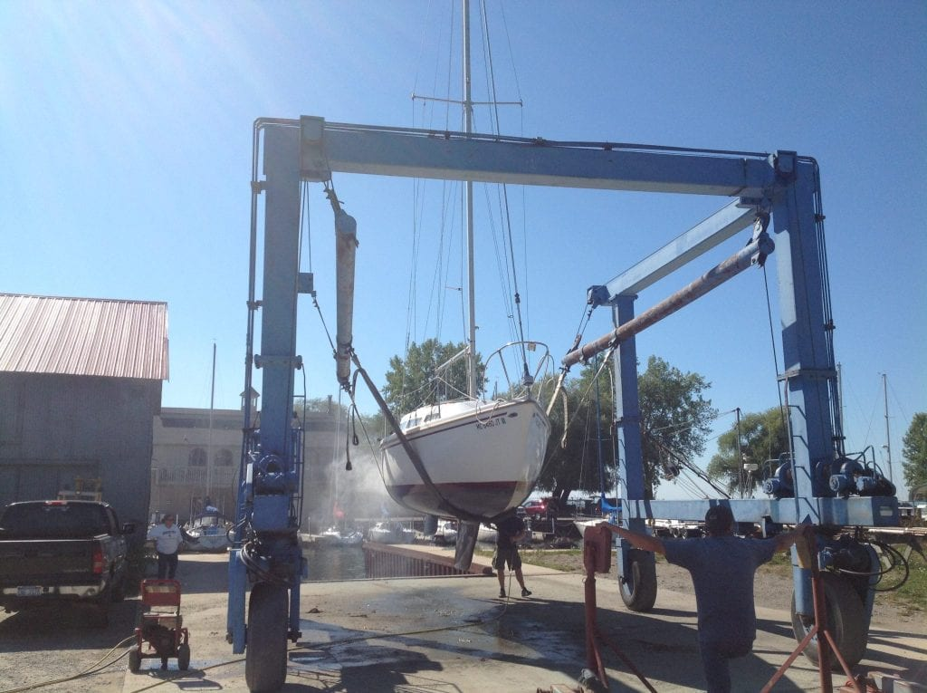 A Sailboat gets lifted out of the water - Caseville Harbor in the Fall
